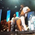 Musician Flavour Feeling A Fan's Behind On Stage